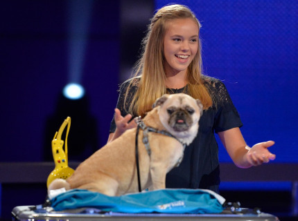 Marissa Streng holds her hands out toward her dog Mojo.
