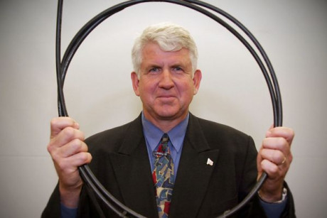 Bob Metcalfe holding an Ethernet cable