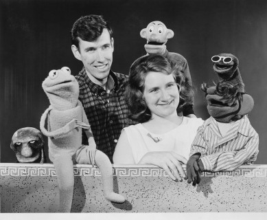 Jim and Jane Henson pose with several puppets.