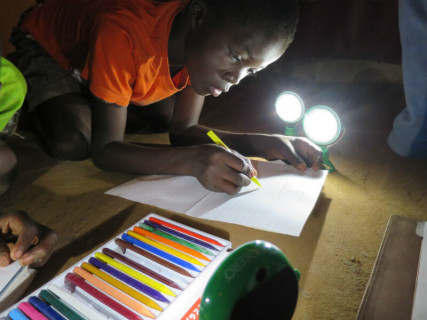 Image: Student studying at night using solar lights