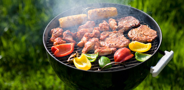 Grill filled with a variety of summer foods