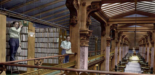Inside of an old library with two men doing research