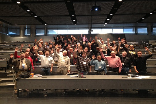 inventors at a USPTO inventors conference all raising their hand
