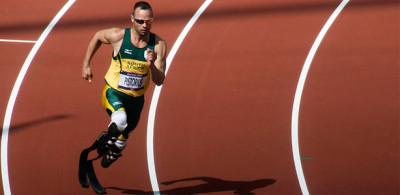"Oscar Pistorius, running with his special carbon fiber ""blade"" prosthetics"