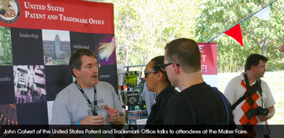 John Calvert of the United States Patent and Trademark Office talking to attendees at the Maker Faire