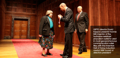 USPTO Director David Kappos presenting Yvone Brill, Inventor of the hydrazine resistojet propulsion systems with the Inventors Hall of Fam Induction medal