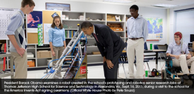 President Barack Obama examines a robot created in the school's prototyping and robotics senior research labs at Thomas Jefferson High School for Science and Technology in Alexandria, VA