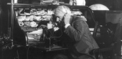 Black and White image of a man on a telephone