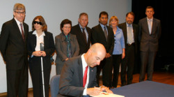 USPTO Director David Kappos signs patent number 8 million at a signing ceremony hosted by the USPTO at the Smithsonian American Art Museum
