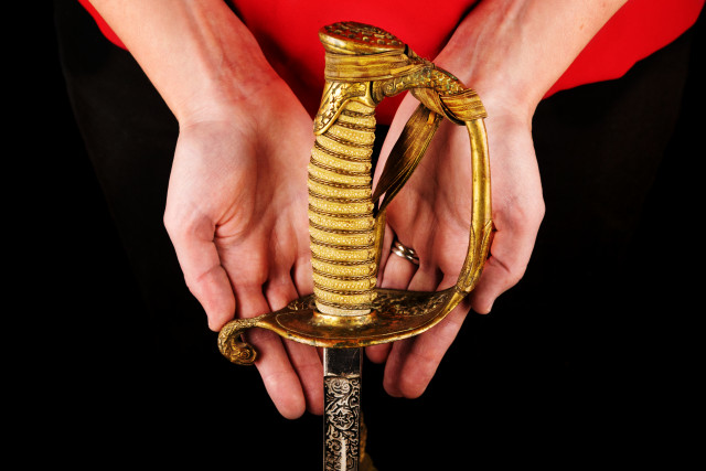 hands holding Sword that belonged to owner's great uncle