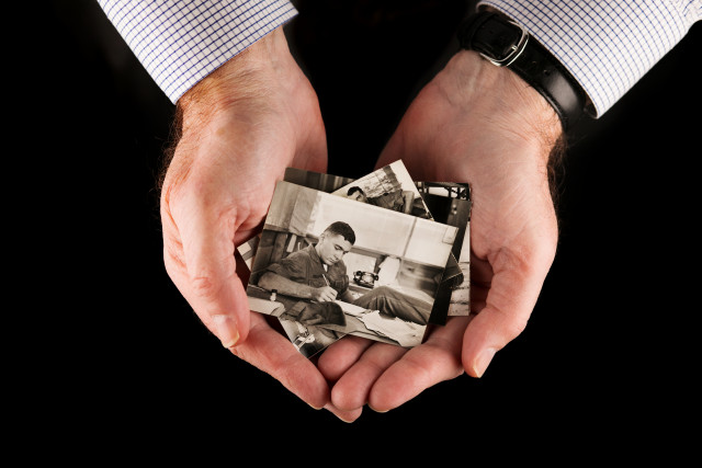 Hands holding Photo of 22-year-old Second Lieutenant John Palafoutas in Vietnam, 1967.