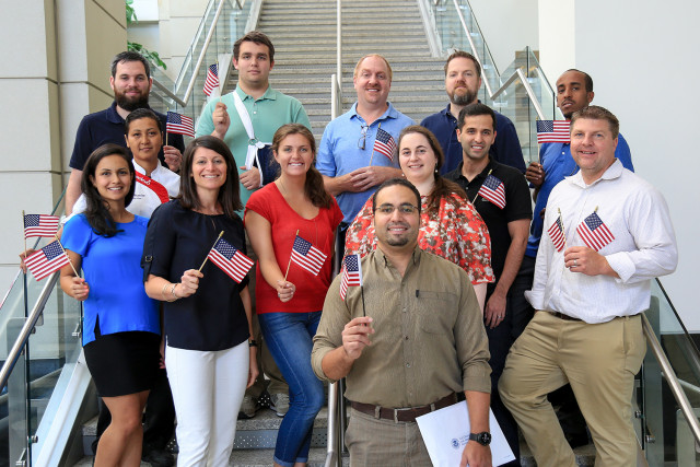 Conference Services staff celebrate the new citizenship of one of their team members