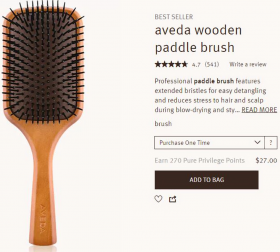 Aveda specimen shows trademark use for hairbrushes. The specimen is a screenshot of a webpage for purchasing the hairbrush. The screenshot shows trademark carved on the brush handle.
