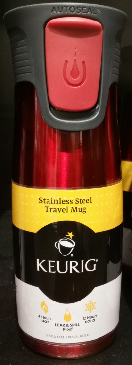 Keurig specimen shows trademark use for travel mugs. The specimen is a photograph of a travel mug with an attached label. The trademark is shown prominently in the center of the label.