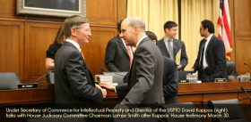 Under Secretary of Commerce for Intellectual Property and Director of the USPTO David Kappos talking with House Judiciary Committee Chairman Lamar Smith after Kappos' House testimony